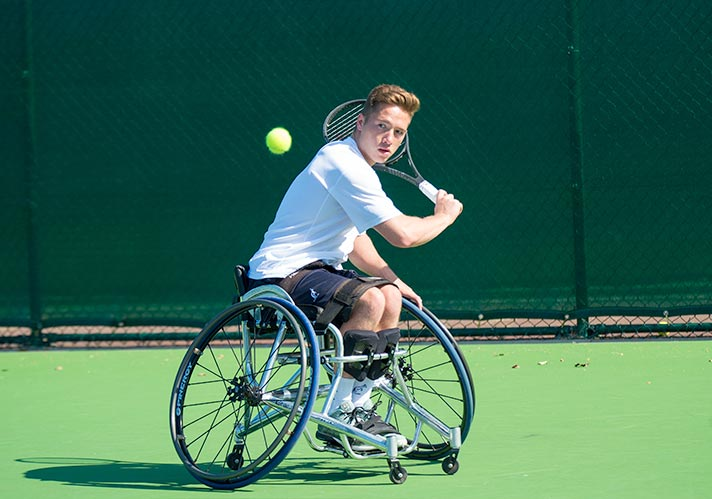 Alfie Hewett playing wheelchair tennis